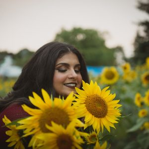 A woman poses with yellow sunflowers in Mississauga Ontario